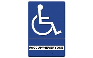International symbol for a person in a wheelchair in white on blue background. Underneath it reads: #OCCUPY4EVERYONE in black on white, and below that is a word or phrase in Braille.